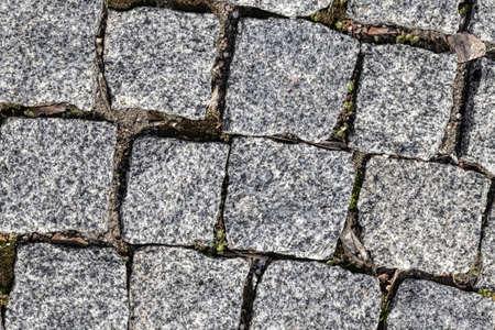 a road made of concrete tiles for pedestrian