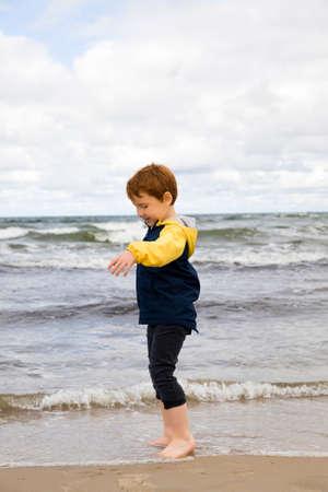 one boy in a yellow and black jacket 版權商用圖片
