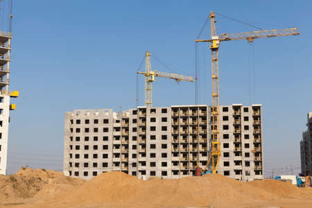 construction of residential buildings with a large number of floors and residential apartments and premises, high-rise housing for people and families in a large city, Eastern Europe, modern multi-storey buildings with all communal amenities 스톡 콘텐츠
