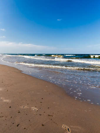 the undulating surface of the sea during a strong wind, the summer Baltic sea, beautiful nature on a sea walk 스톡 콘텐츠