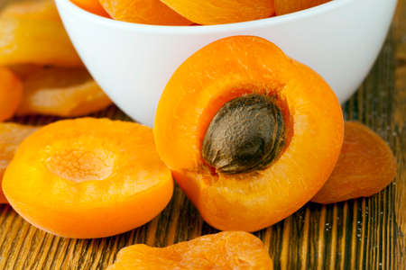 cut apricots in a glass white bowl, delicious and healthy fruits, apricots red and yellow, food close-up
