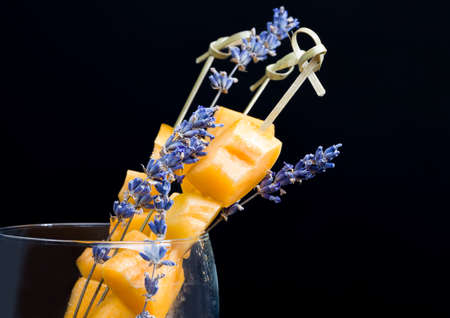 sliced orange peaches or apricots, while cooking, peaches or apricots together with dry fragrant lavender flowers, closeup