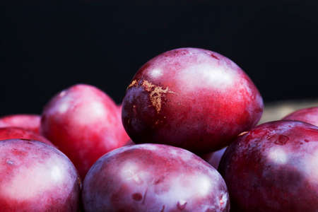 red homemade plums during cooking, delicious and healthy ripe red plums, plum fruit details closeup
