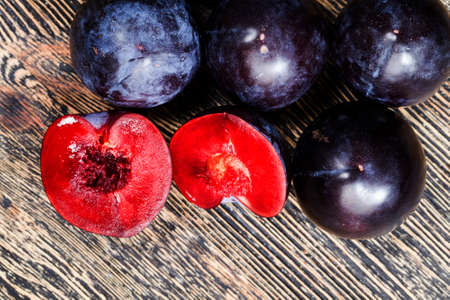 red homemade plums during cooking, delicious and healthy ripe red plums, plum fruit details