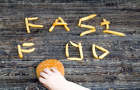 fresh French fries are inexpensive convenient fast food, unhealthy food, natural deep-fried potatoes, crispy French fries