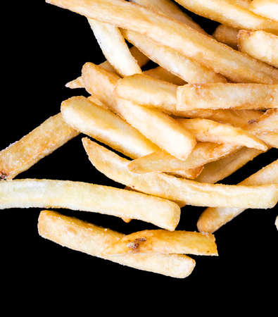 fast food French fries, inexpensive convenient fast food from natural deep fried potatoes, closeup crispy French fries 스톡 콘텐츠