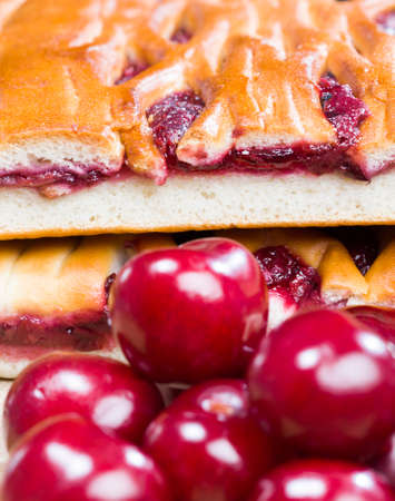 traditional cherry cake made from wheat flour and berries of red cherry jam, cut into pieces Standard-Bild