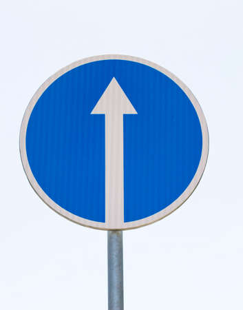 reflective car road sign indicating the direction of the car only straight, white straight arrow on a blue background, traffic control on the roads