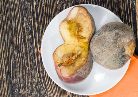 several peaches covered with mold due to improper storage, top view Standard-Bild