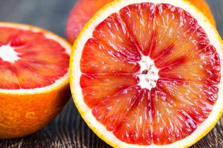 red orange delicious orange fruit, cut into halves during the preparation of desserts Standard-Bild