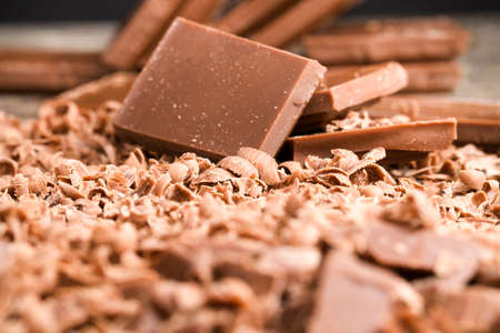 crumbs from delicious chocolate that are used in confectionery production, details and close-up