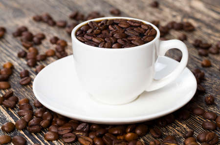beautiful coffee beans coffee floating in brown cooked coffee drink, drinks closeup