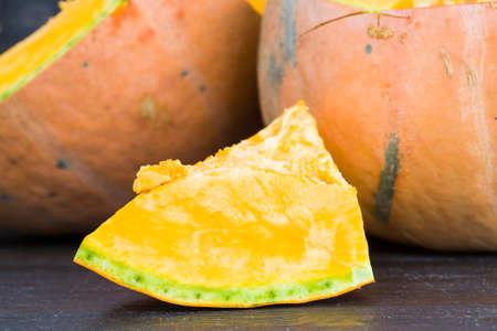 cooking orange ripe pumpkin, slicing vegetables into cubes of different sizes for cooking porridge Standard-Bild