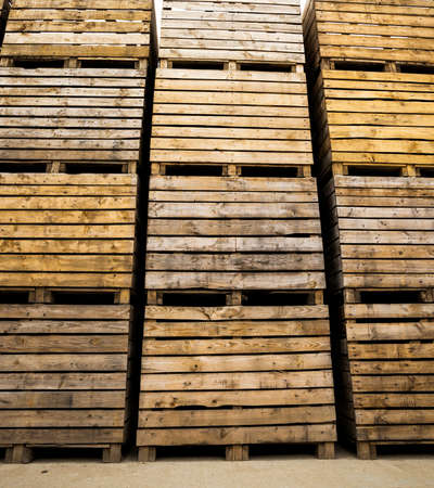 old wooden boxes for storing vegetables and fruit harvest after harvest, storage facilities on the farm, cloudy weather