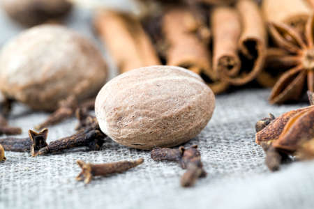 different kinds of spices lie together, cooking in the kitchen using star anise, cinnamon, nutmeg and other types of fragrant spices