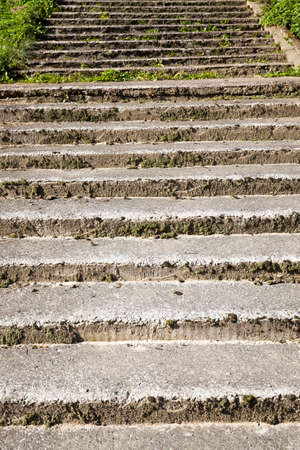 the crumbling old concrete stairs are made of faux concrete and fine aggregate, part and parts of old structures outdoor
