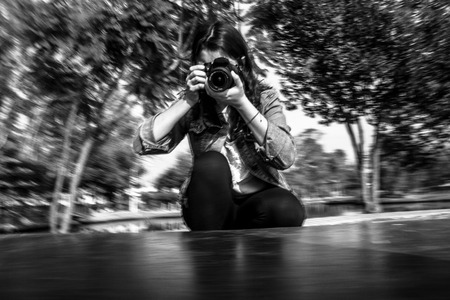 Photographer in motion in black and white Stock Photo