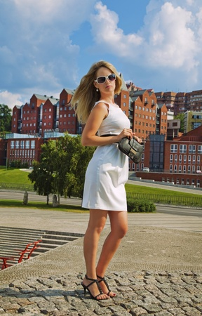 The young businesswoman in white dress in the city photo