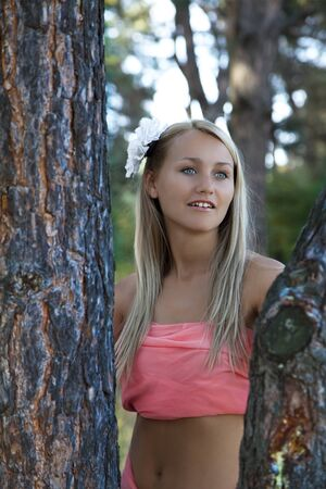 Portrait of beautiful romantic woman in  forest in summer