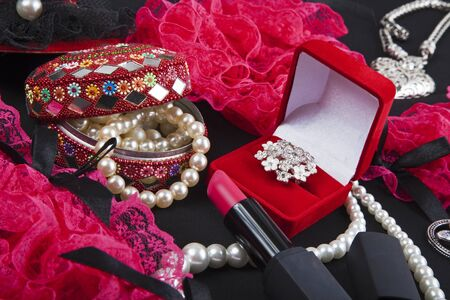 Woman and Female Accessories on black background