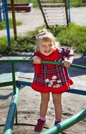 Adorable little girl playing in the playground photo