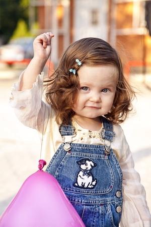 Baby girl happy portrait with balloon