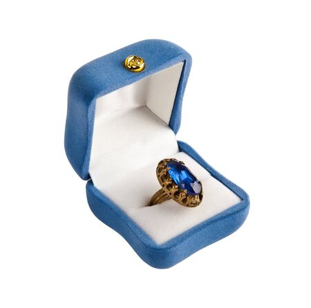 Golden ring with blue stone isolated on the white background  photo