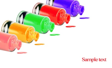 Bottles with spilled nail polish over white background  Stock Photo