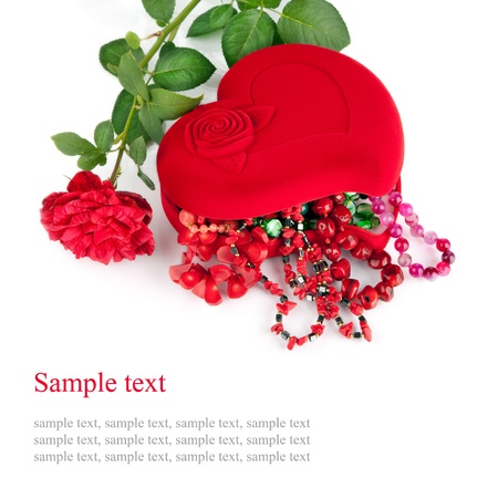 semiprecious: Red heart-shaped casket with beads of  semi-precious stones and rose  isolated on  white background