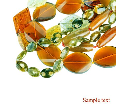 amber coloured: Lot of yellow beads from different minerals and stone background