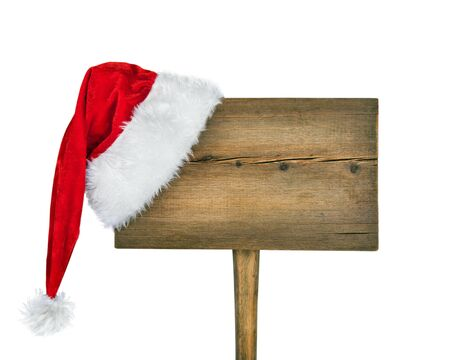 wooden road sign with Santa  hat isolated on a white background  photo