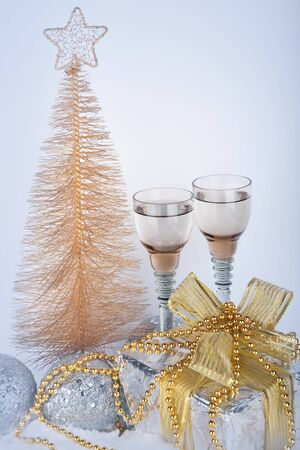 Champagne, gift box, snow, christmas toys and fir-tree  New Year s attributes  photo