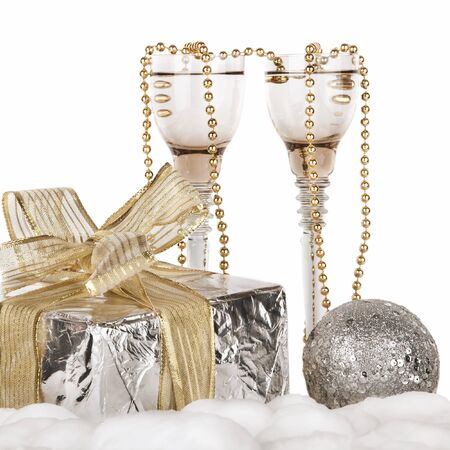 Champagne, gift box, snow and Christmas toys photo