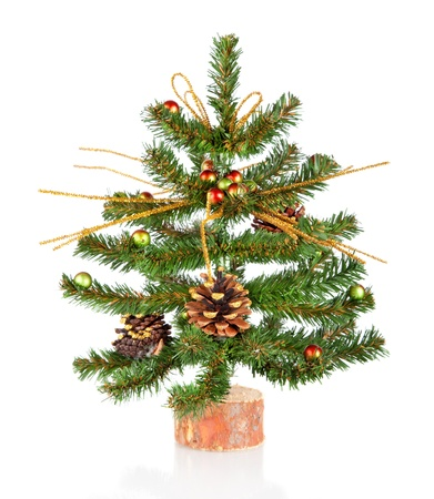 Small decorated Christmas tree isolated on white background  Stock Photo