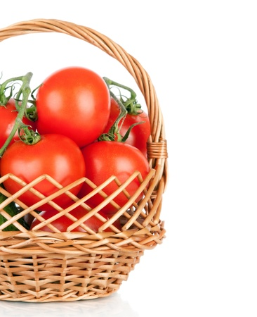 Basket of tomatoes and cucumbers  Fresh vegetables isolated on white