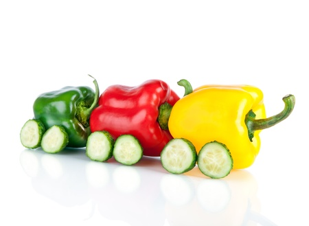 Train made of various sweet pepper vegetables and cucumbers isolated on white background
