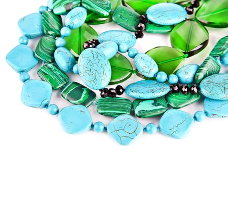bead jewelry: Lot of colored beads from different minerals  Stone background Stock Photo