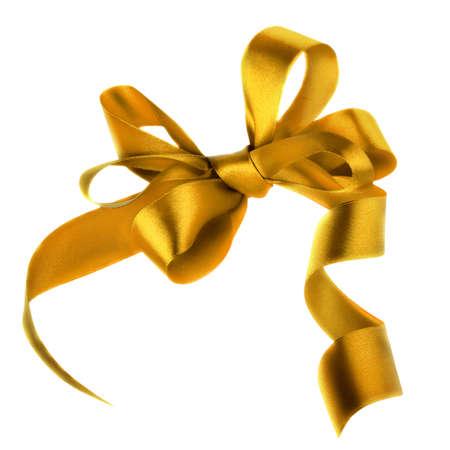 Golden satin gift bow  Ribbon  Isolated on white Stock Photo