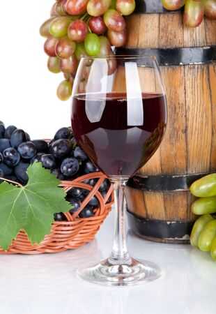 barrel, bottles, grapes and glass of  red wine