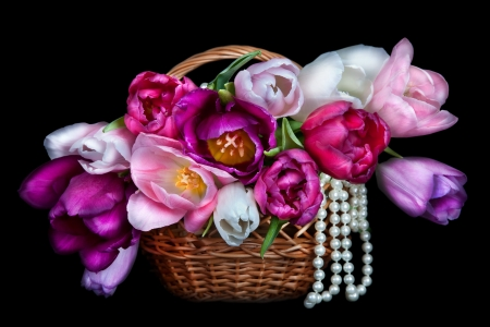 Basket with colorful bouquets of tulips flowers on black background  photo