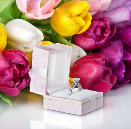 Bouquet of beautiful tulips flowers and wedding ring