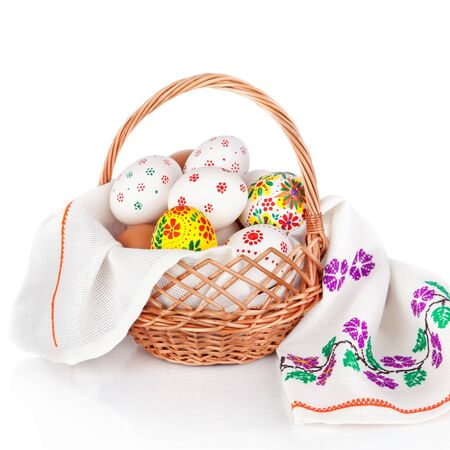 basket embroidery: Easter eggs in basket isolated on white background