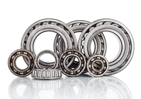 Composition of steel ball roller bearings in closeup isolated on white background