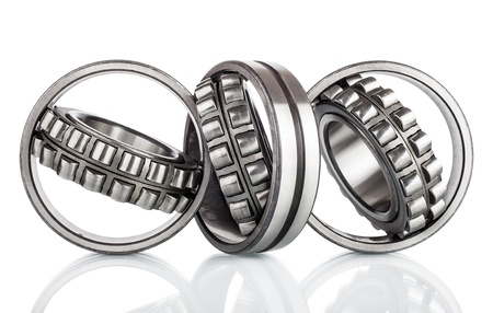 Composition of steel ball roller bearings in closeup isolated on white background photo