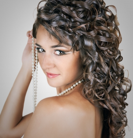 Portrait of beautiful young seductive sexy girl the bride with the imposed make-up and a hairdress