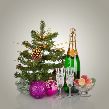 Champagne, fir tree and Christmas decor  New Year Stock Photo