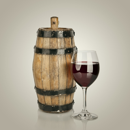 red wine and wooden barrel photo