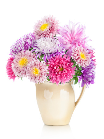 bouquet of aster flowers in  pot isolated on white background photo