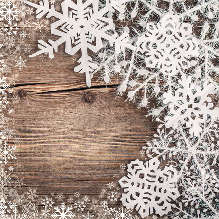 Christmas snowflakes on wooden background photo
