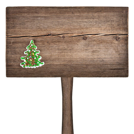 Christmas green fir tree on a wooden board. New Year background